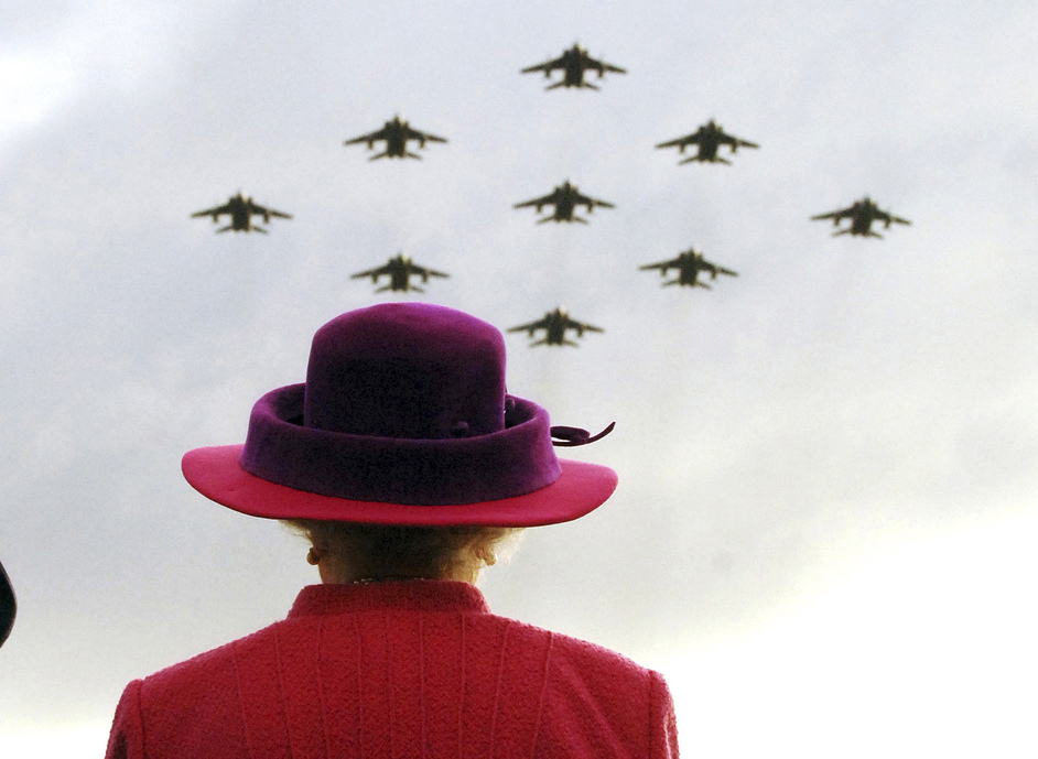 The Queen: Sixty Photographs for Sixty Years - The Queen watches a flypast of RAF Jaguars during her visit to RAF Coltishall, Norfolk, 17 November 2005. Photograph: Arthur Edwards, MBE, (c) The Sun