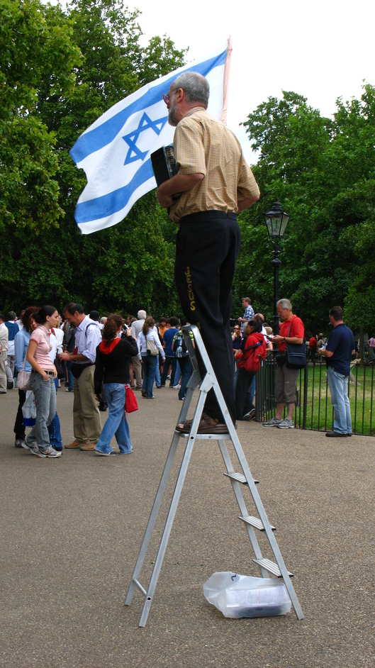 Speakers' Corner - He stands out as one of the many colourful speakers with his Israeli flag, bible and Jesus pants.