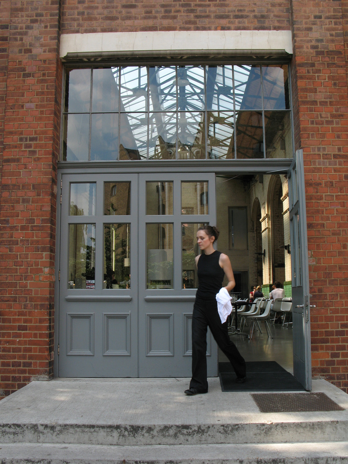The Wapping Project - An employee exiting one of the doors into the building.