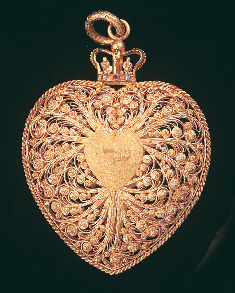 Jewish Museum - 19th century English amulet in the form of a heart locket with Hebrew characters. Credit: Jewish Museum London