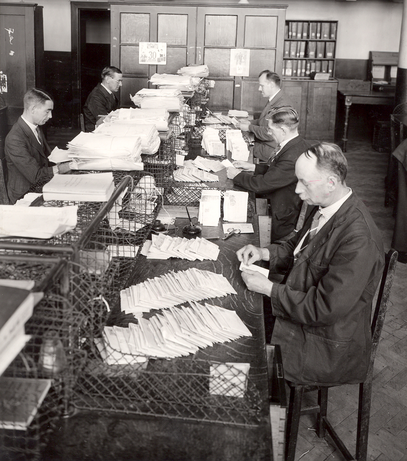 The Postal Museum and Mail Rail - Clerks working in the Return Letter Office, Mount Pleasant, 1934
