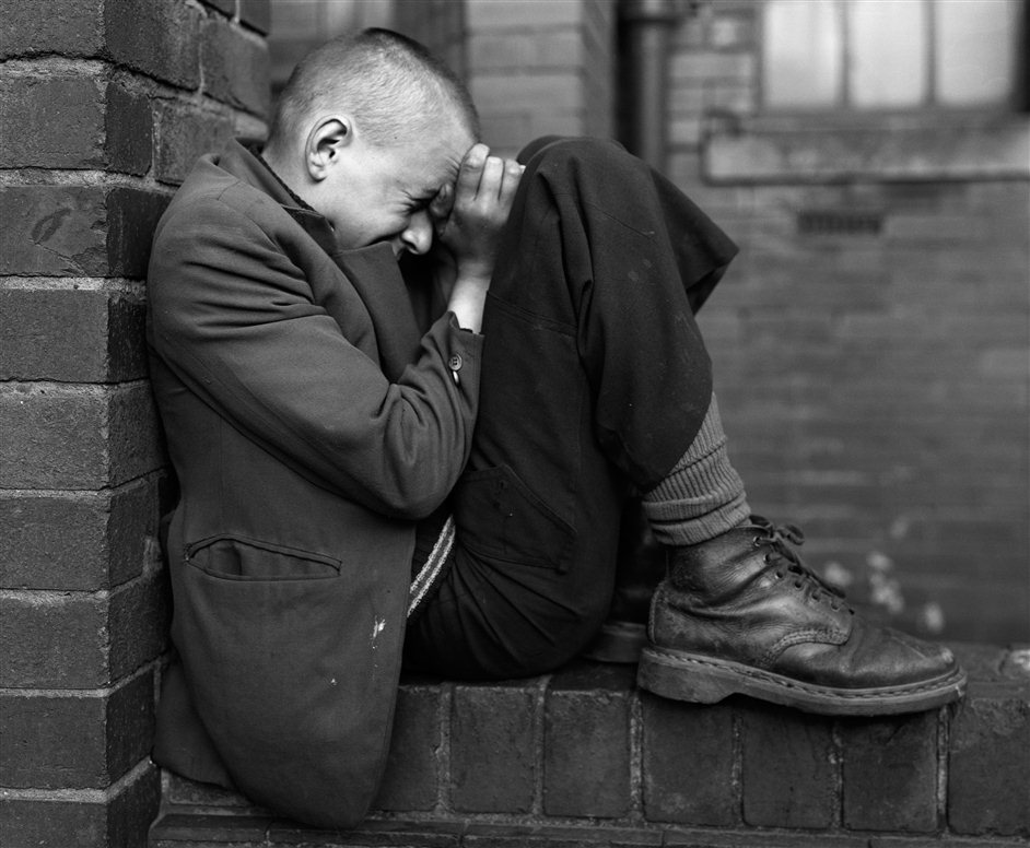 Deutsche Borse Photography Prize 2013 - Chris Killip,,Youth on Wall, Jarrow, Tyneside, 1976,,© Chris Killip,,Courtesy of the artist and The Photographers' Gallery,,,London
