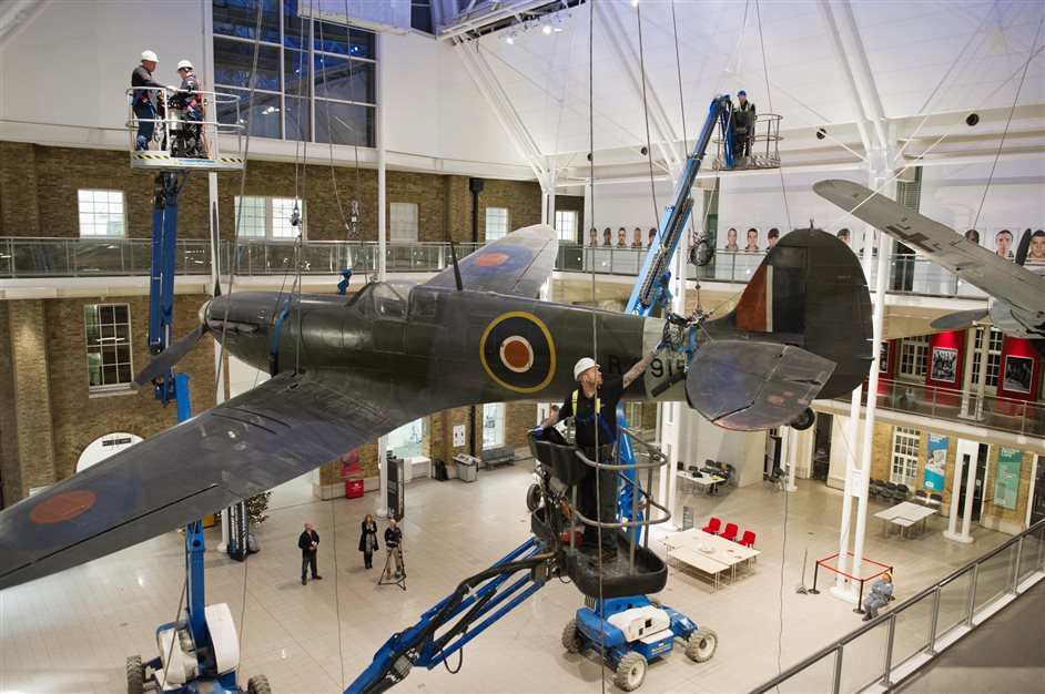 IWM London (Imperial War Museums) - Spitfire Lowering. Photo by permission of IWM (Imperial War Museums)