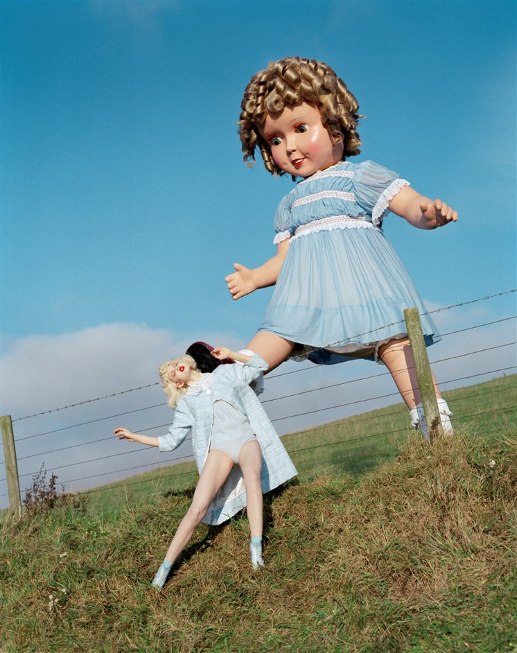 Tim Walker: Story Teller - Giant doll kicks Lindsey Wixson, Eglingham Hall, Northumberland, 2011 © Tim Walker