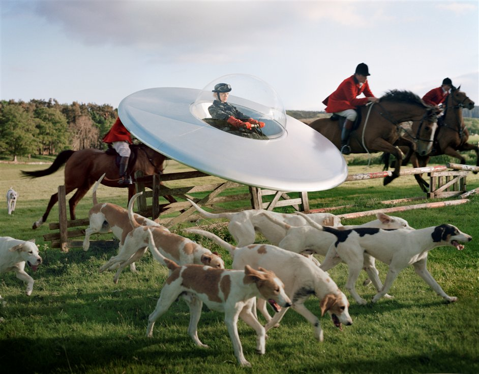 Tim Walker: Story Teller - Kinga Rajzak in flying saucer with members of the West Percy Hunt, Eglingham Hall, Northumberland, 2009 © Tim Walker