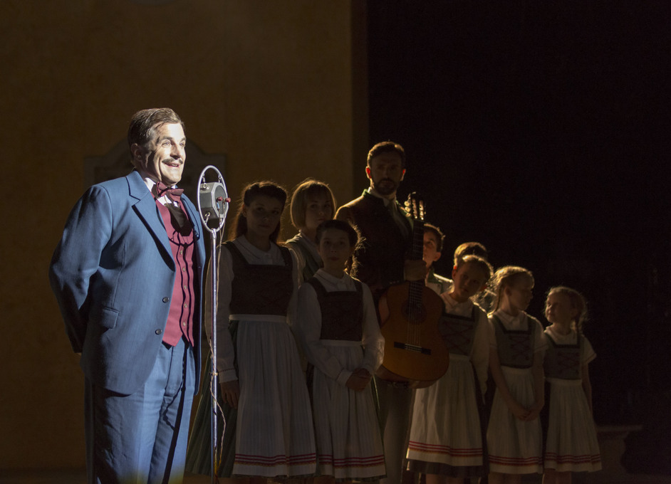 The Sound of Music - Michael Matus as Max with the von Trapp family. Photo by Johan Persson