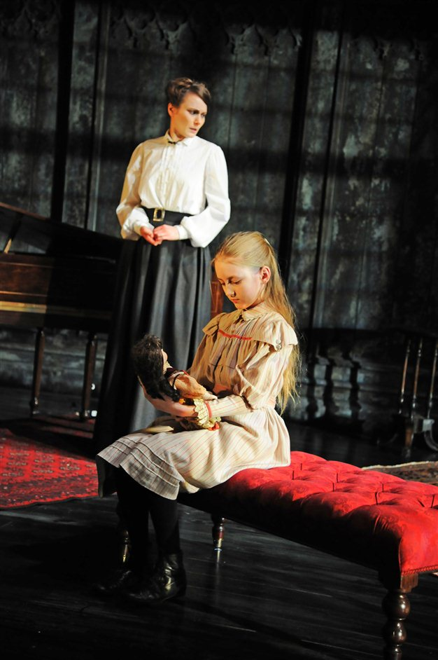 The Turn Of The Screw - Anna Madeley (Governess) and Lucy Morton (Flora). Photo by Nobby Clark