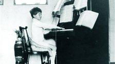 Britten's War Requiem - Britten1921 - Playing piano at home. Image courtesy of www.britten100.org.