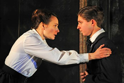 The Turn Of The Screw - Anna Madeley (Governess) and Laurence Belcher (Miles). Photo by Nobby Clark