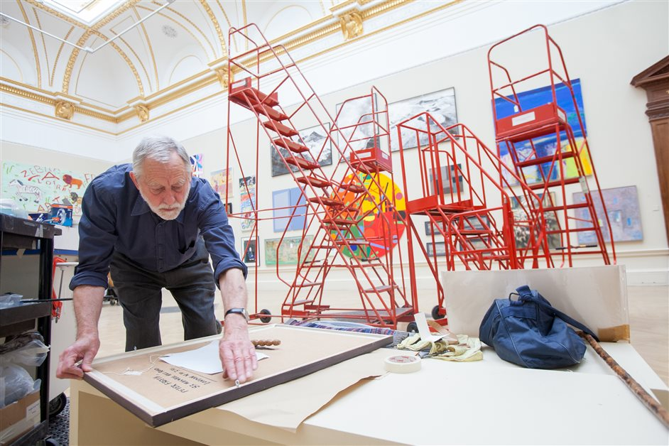 Royal Academy Summer Exhibition - Peter Freeth RA, installing the Summer exhibition 2013. Photo by Benedict Johnson