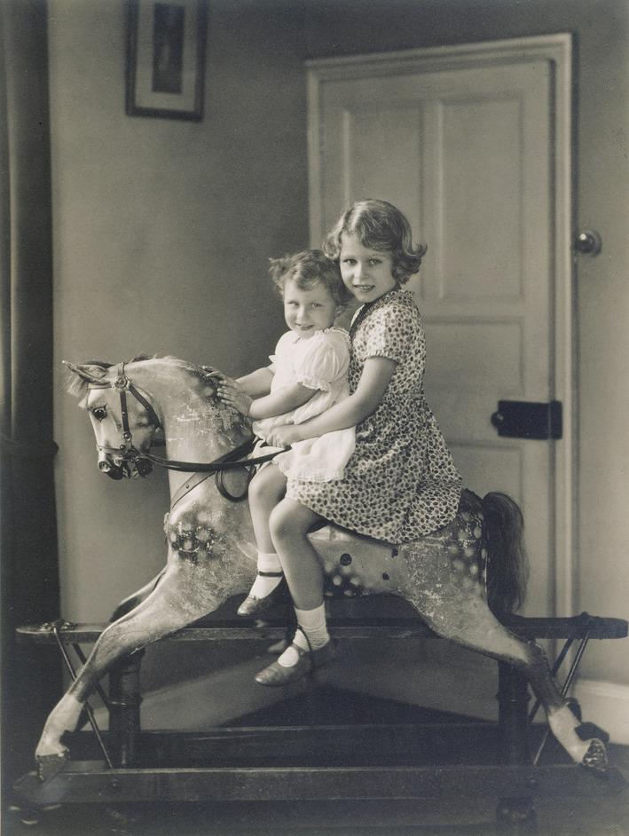 Royal Childhood - Princess Elizabeth and Princess Margaret on a rocking horse, August 1932. Royal Collection Trust / (C) Her Majesty Queen Elizabeth II 2014