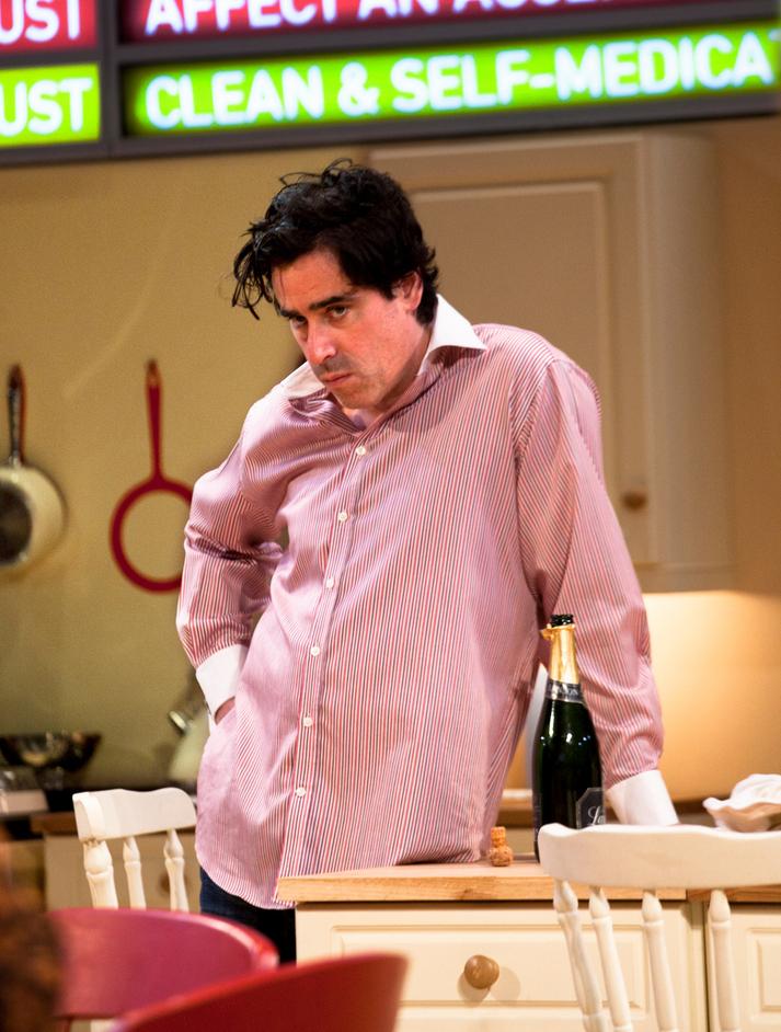Table - Stephen Mangan (Adam). Photographer: Simon Annand