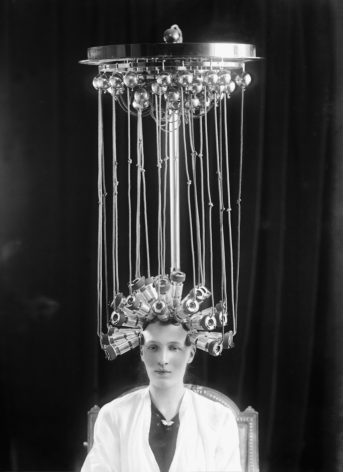 Electricity: The Spark of Life - Woman modelling a hairstyle for the hairdresser Eugene Ltd c 1923