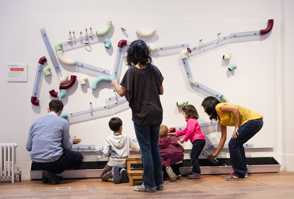 Wonderlab: The Statoil Gallery - Visitors play with Gravity Run. Plastiques Photography