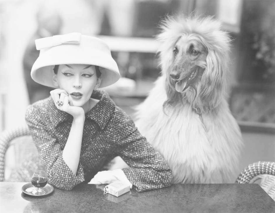 Balenciaga: Shaping Fashion - Dovima with Sacha, cloche and suit by Balenciaga, Café des Deux Magots, Paris, 1955. Photograph by Richard Avedon (c) The Richard Avedon Foundation