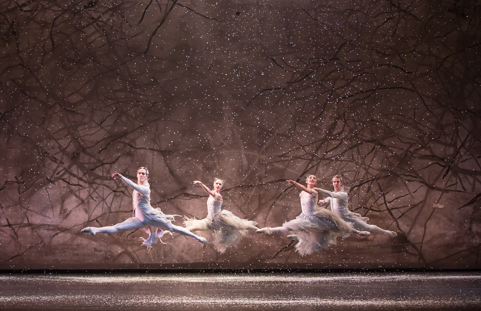 Birmingham Royal Ballet: The Nutcracker - Yvette Knight and Yijing Zhang as Snowflakes with William Bracewell and Valentin Olovyannikov as Winds; photo: Andrew Ross
