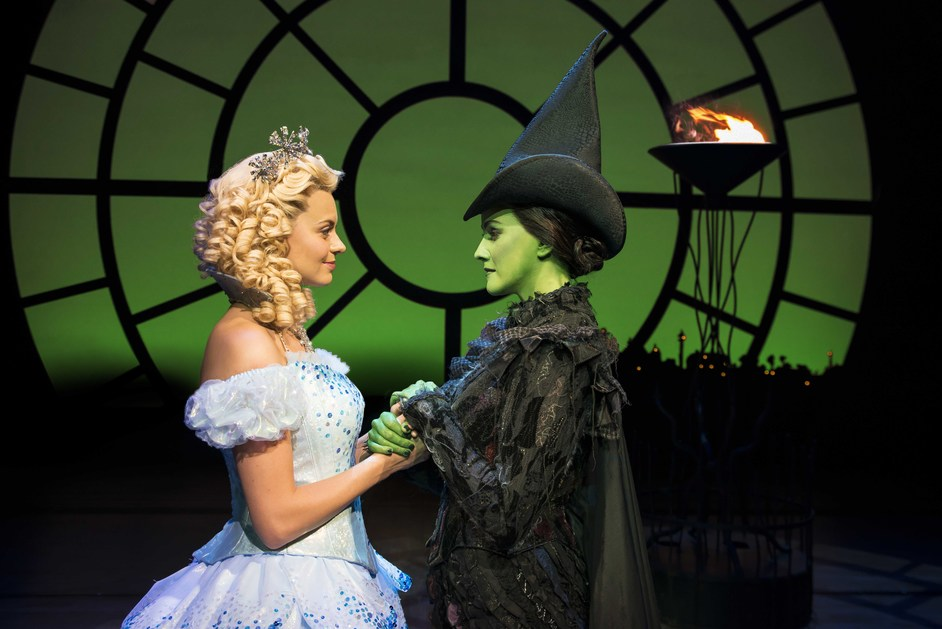 Wicked - Sophie Evans (Glinda) and Alice Fearn (Elphaba) in Wicked at Apollo Victoria. Photo by Matt Crockett