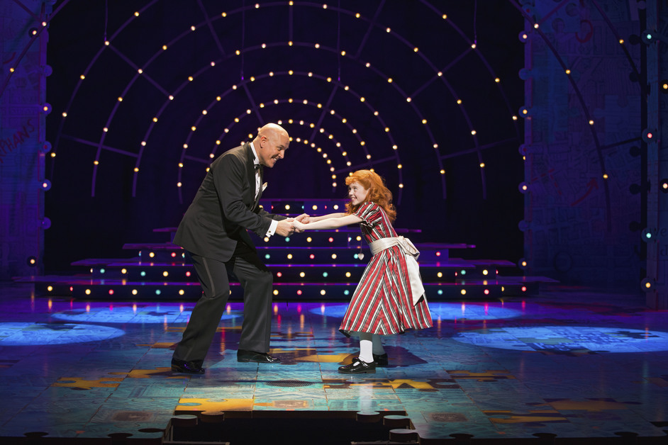 Annie - L-R: Alex Bourne (Daddy Warbucks) and Agatha Meehan (Annie) - West End production of Annie. Photo: Darren Bell