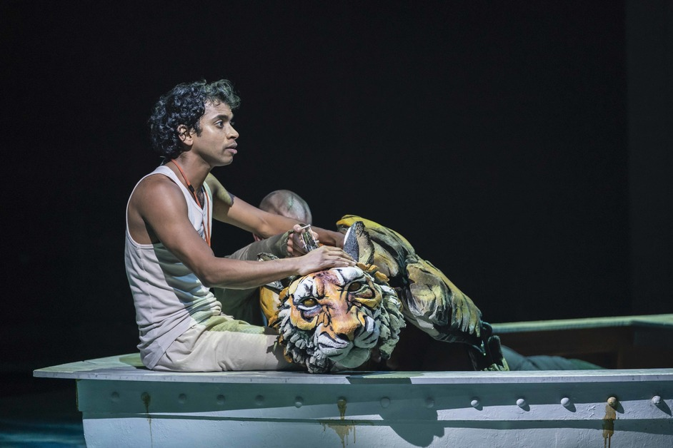 Life of Pi - Hiran Abeysekera (Pi) and Richard Parker the Tiger in Life of Pi. Photo: Johan Persson