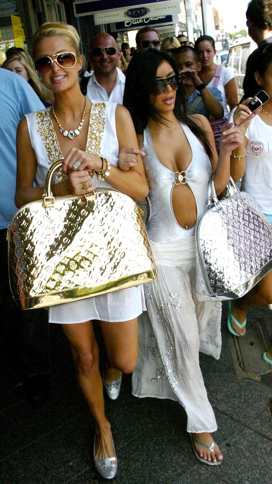 Bags: Inside Out - Paris Hilton and Kim Kardashian with Marc Jacobs for Louis Vuitton 'Monogram Miroir' gold speedy handbags in Sydney, Australia, 2006. Photo by PhotoNews International Inc/Getty Images