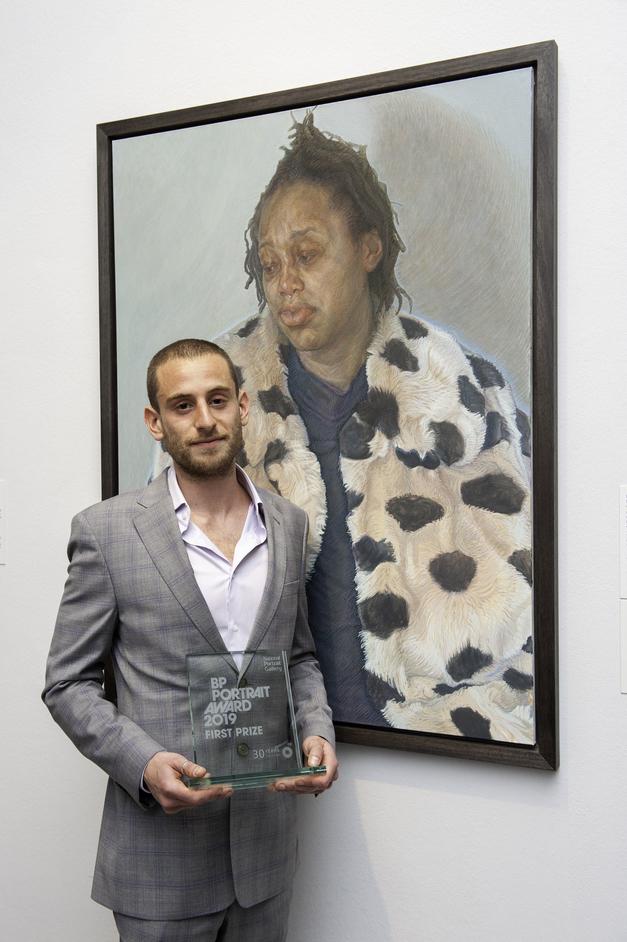 BP Portrait Award 2019 - BP Portrait Award 2019. First Prize Winner Charlie Schaffer with his portrait Imara in her Winter Coat. Photograph by Jorge Herrera